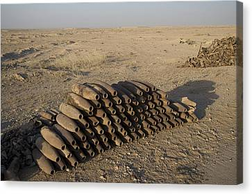Inert Artillery Shells Are Stacked Canvas Print by Terry Moore