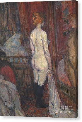 Woman Before A Mirror Canvas Print by Henri de Toulouse-Lautrec