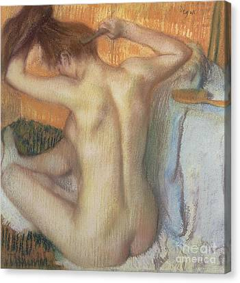 Woman Combing Her Hair Canvas Print by Edgar Degas