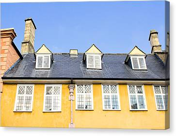 Yellow Building Canvas Print by Tom Gowanlock