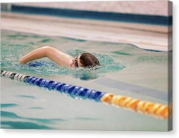 Young Swimmer Canvas Print by Peter Lakomy