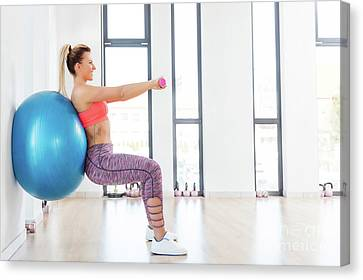 Fitness Instructor Canvas Print - Young Woman Training With Fitball At Fitness Club. by Michal Bednarek