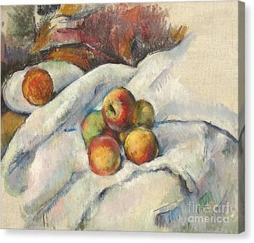 Apples On A Cloth Canvas Print by Paul Cezanne