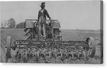 A Farmer Driving A Tractor Canvas Print by American School