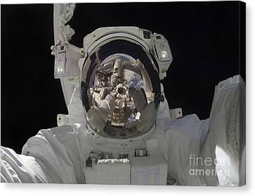 Astronaut Uses A Digital Still Camera Canvas Print by Stocktrek Images