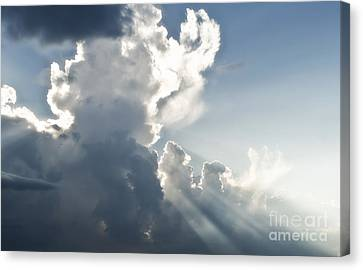 Cloudy Sky With Sun Rays Canvas Print by Blink Images