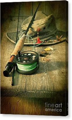 Fly Fishing Equipment With Old Hat On Bench Canvas Print by Sandra Cunningham