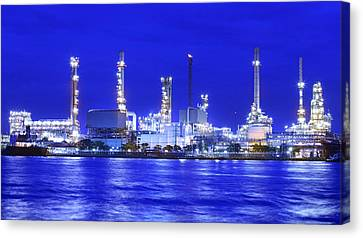 Landscape Of River And Oil Refinery Factory  Canvas Print by Anek Suwannaphoom