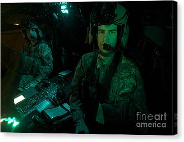 Pilots Sitting In The Cockpit Canvas Print