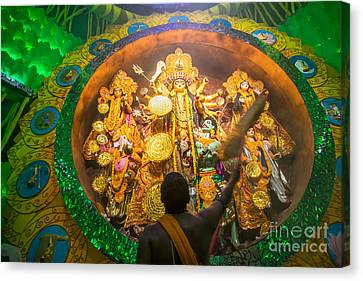 Priest Praying To Goddesss Durga Durga Puja Festival Kolkata India Canvas Print by Rudra Narayan  Mitra