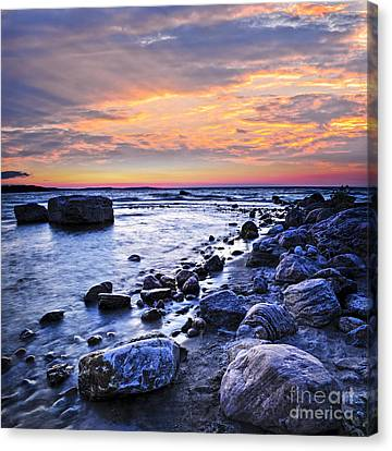 Sunset Over Water Canvas Print by Elena Elisseeva