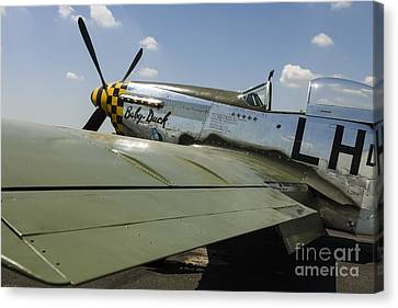 A P-51 Mustang Parked On The Ramp Canvas Print by Rob Edgcumbe