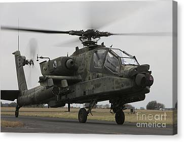 Ah-64 Apache Helicopter On The Runway Canvas Print by Terry Moore