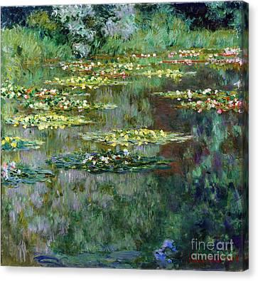Le Bassin Des Nympheas Canvas Print by Claude Monet