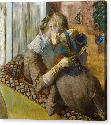 At The Milliner's Canvas Print by Edgar Degas