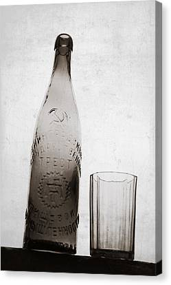 Canvas Print featuring the photograph Vintage Beer Bottle by Andrey  Godyaykin