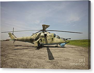 An Mi-35 Attack Helicopter At Kunduz Canvas Print by Terry Moore