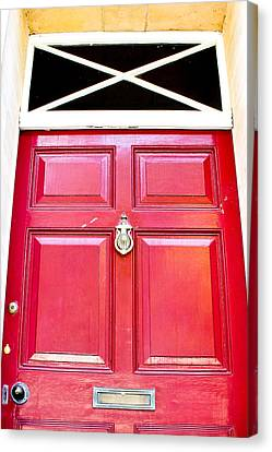 Red Door Canvas Print by Tom Gowanlock