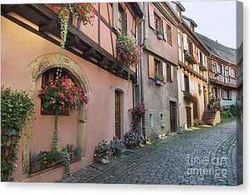 Streets Of Eguisheim Canvas Print by Yefim Bam