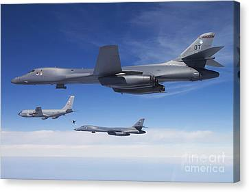 A B-1b Lancer Stands By As Another Canvas Print by Stocktrek Images