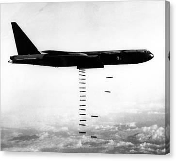 A B-52 Stratofortress Releases Bombs Canvas Print by Everett