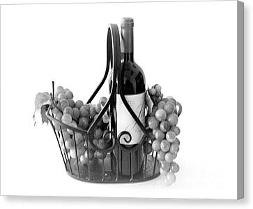A Basket Of Wine And Grapes Canvas Print by Sherry Hallemeier