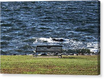 Canvas Print featuring the photograph A Bench By The Sea by Tom Prendergast