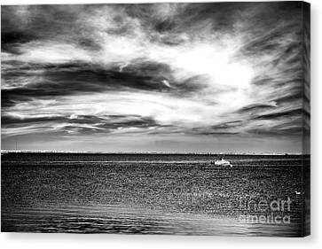 A Boat In The Bay Canvas Print by John Rizzuto