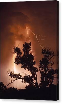 A Bolt Of Lightning Brightens A Night Canvas Print by Rex A. Stucky