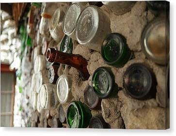 A Bottle In The Wall Canvas Print by Jeff Swan