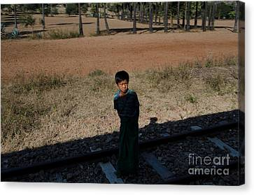 A Boy In Burma Looks Towards A Train From The Shadows Canvas Print