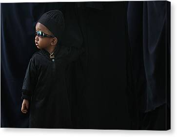 A Boy In The Rows Of Women Canvas Print by Arfah Aksa