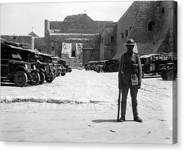 A British Soldier In Front Of Nativity Church Canvas Print by Munir Alawi