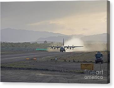 A C-130 Taking Off Canvas Print by Tim Grams