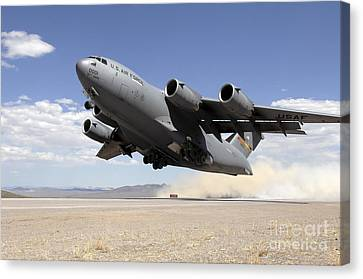 A C-17 Globemaster Departs Canvas Print by Stocktrek Images