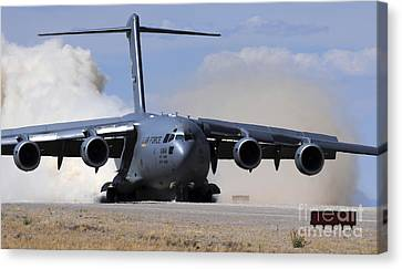 A C-17 Globemaster Lands On The Runway Canvas Print