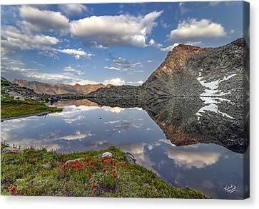 A Calm Mountain Lake Canvas Print by Leland D Howard