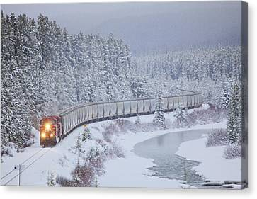 A Canadian Pacific Train Travels Along Canvas Print by Chris Bolin