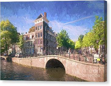 A Canal In Amsterdam Canvas Print by Philip Preston