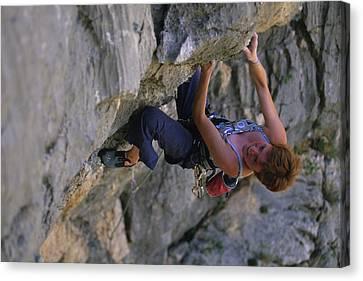 A Caucasian Woman Rock Climbing Canvas Print by Bobby Model