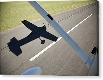 A Cessna Light Aircraft Taking Off The Shadow Tells The Story Canvas Print by Richard Du Toit