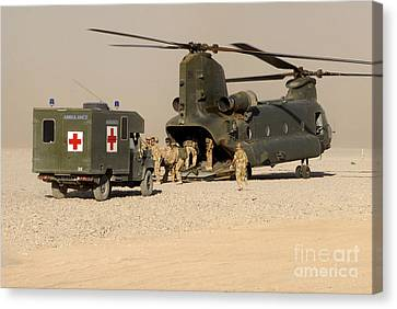 A Ch-47 Chinook Helicopter Drops Canvas Print by Andrew Chittock