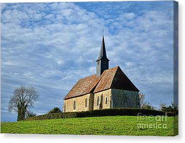 A Church In France Canvas Print by Olivier Le Queinec