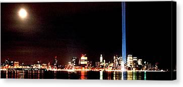A City's Lights Canvas Print by Richard Gerken