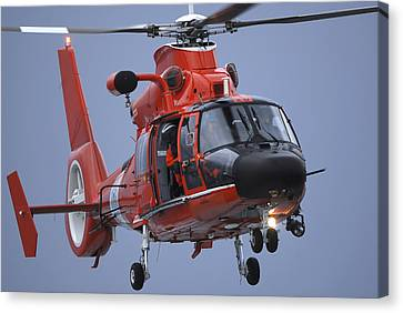 Law Enforcement Canvas Print - A Coast Guard Mh-65 Dolphin Helicopter by Stocktrek Images
