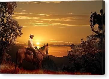 A Cowboy Riding On His Horse Into A Yellow Sunset. Canvas Print by Peter Nowell