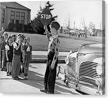 A Crossing Guard Holds Up Sign Canvas Print by Underwood Archives