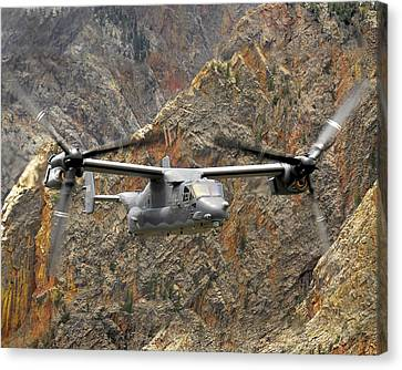 A Cv-22 Osprey Flies Over The Canyons Canvas Print by Stocktrek Images