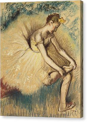 A Dancer Putting On Her Shoe Canvas Print