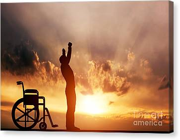 A Disabled Man Standing Up From Wheelchair Canvas Print by Michal Bednarek